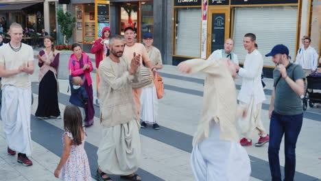 A-Group-Of-Happy-Hare-Krishnas-Dance-And-Sing-In-The-Center-Of-Stockholm