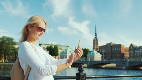 A-Woman-In-Sunglasses-Is-Resting-On-The-Stockholm-Embankment-Holiday-In-Europe-Concept-4k-Video