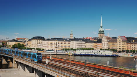 The-City-Line-Of-Stockholm-In-The-Foreground-The-Train-Passes-Transport-In-The-Capital-Of-Sweden