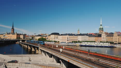 Subway-Train-Travels-Across-The-Bridge-Against-The-Backdrop-Of-The-Stockholm-City-Line-Sweden