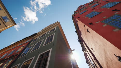 Multicolored-Old-Houses-In-Stockholm-Beautiful-European-Architecture-The-Sun-Shines-From-Behind-The-