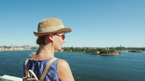 The-Woman-Admires-The-Beautiful-View-Of-The-Lake-And-The-Islands-Of-Stockholm-Travel-To-Scandinavia-