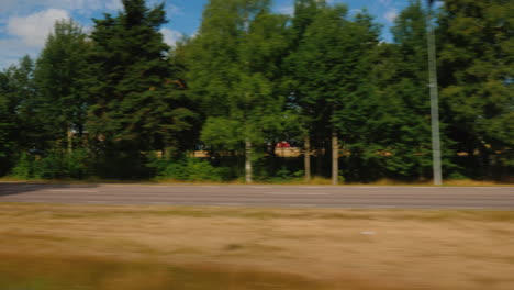 Travelling-On-A-Scenic-Road-In-Sweden-A-View-From-A-Car-Window-4k-Window