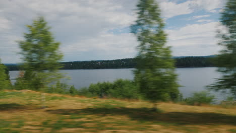 Travel-Along-A-Scenic-Road-Along-A-Lake-In-Sweden-4k-Video