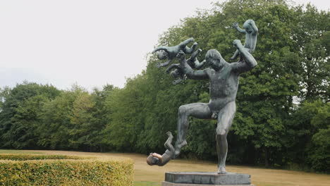 Sculpture-Of-A-Man-Who-Juggles-With-Babies-An-Interesting-Composition-In-The-Sculpture-Park-Of-Gusta