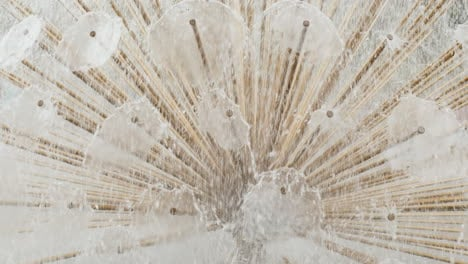A-Close-Up-Of-A-Detail-Of-A-Fountain---Water-Flows-From-Thin-Pipes-Background-Of-Water-Jets