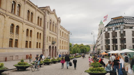 People-Stroll-Around-The-Parliament-Building-In-Oslo