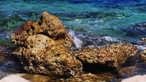 Surf-Hits-Rocks-From-Old-Corals