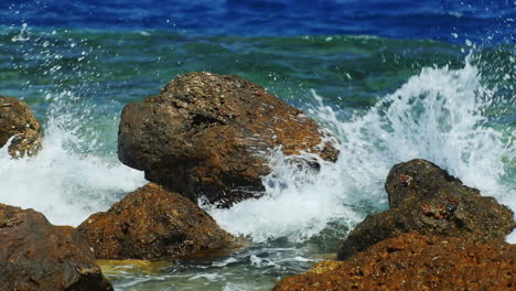 Sea-Waves-Breaking-On-The-Rocks-With-Plenty-Of-Water-Splashing