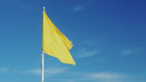 Yellow-Flag-On-A-Background-Of-The-Sky