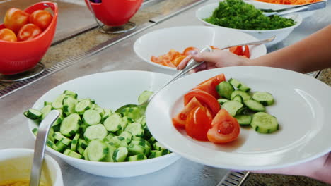 Take-The-Sliced-Cucumbers-On-The-Plate-And-Watering-Sauce-In-The-Cafe-With-Self-Service
