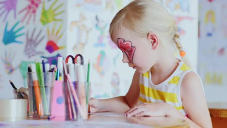 Girl-With-A-Festive-Make-Up-Draws-In-The-Games-Room
