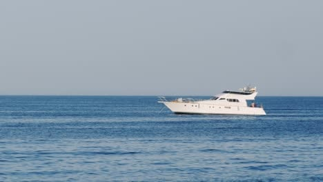 Luxury-White-Yacht-Drifting-In-The-Sea