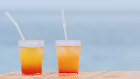 Two-Alcoholic-Cocktail-On-The-Background-Of-The-Sea