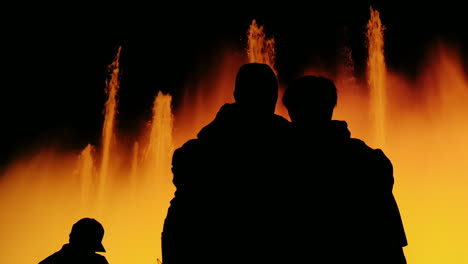 Silhouettes-Of-People-Who-Admire-The-High-Fountain-With-Lights-In-Barcelona