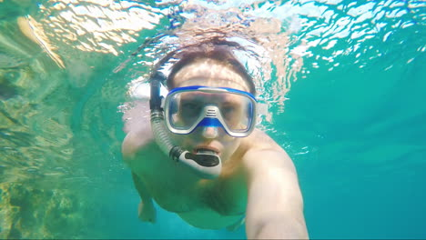 A-Man-Swims-Under-The-Water-In-A-Mask-For-Diving