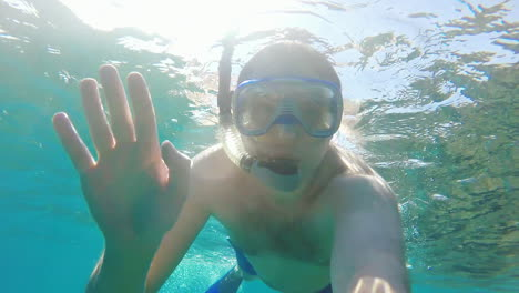 Diver-Makes-Selfie-Waving-At-The-Camera---Underwater