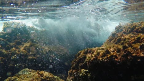 Waves-Breaking-On-The-Rocks---Underwater