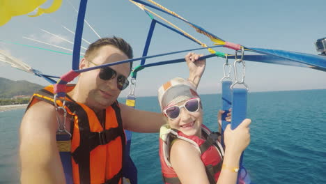 Dad-And-Daughter-Are-Flying-On-Parasailing-A-Father-Takes-A-Selfie-With-A-Girl-An-Active-Vacation-Wi