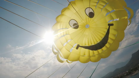 A-Cool-Yellow-Dome-Of-The-Parachute-Against-The-Blue-Sky-And-The-Sun-Poking-Through-It