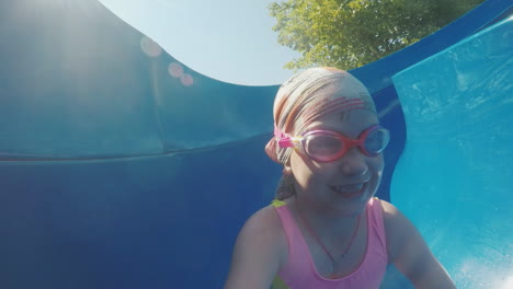 Mom-And-Daughter-Are-Going-Fun-Down-The-Water-Slide-Laughing-Happy-Family-On-Vacation