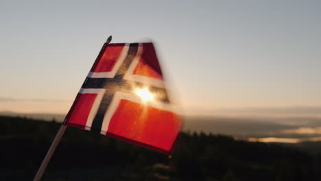 The-Flag-Of-Norway-Flutters-In-The-Wind-The-Sun-Shines-Beautifully-Through-The-Fabric-At-The-Top-Of-