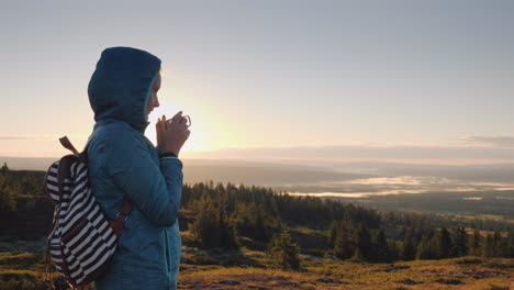 The-Traveler-Drinks-Hot-Tea-On-The-Top-Of-The-Mountain-Admiring-The-Sunrise-On-The-Horizon-Nature-Of