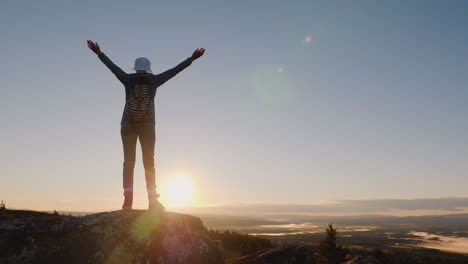 Woman-Traveler-Waving-A-Cap-At-The-Top-Of-The-Mountain-Success-And-Active-Holidays-In-Norway