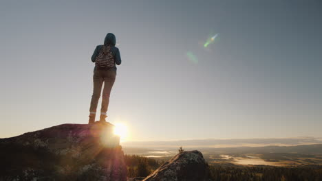 Woman-Tourist-At-The-Peak-Of-The-Mountain-At-Sunrise-Active-And-Healthy-People-Travel-In-Norway