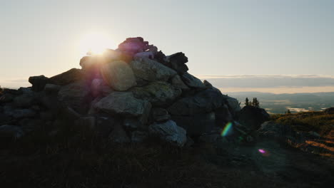 A-Small-Mound-Of-Stones-Lies-On-The-Top-Of-The-Mountain-The-Rays-Of-The-Rising-Sun-Shine-Because-Of-