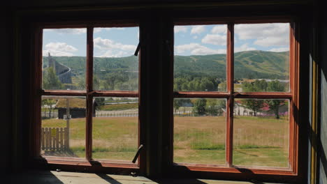 View-Through-An-Old-Vintage-Window-On-A-Beautiful-Landscape-In-Norway-Summer-Trip-To-Scandinavia-Con