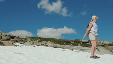 A-Woman-Has-Fun-On-The-Remnants-Of-Snow-On-A-Summer-Day-The-Amazing-Nature-Of-Norway
