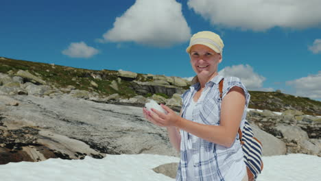 Happy-Woman-Playing-Snowballs-On-A-Glacier-In-Norway-Hot-Summer-But-The-Snow-Has-Not-Melted-Yet---Th