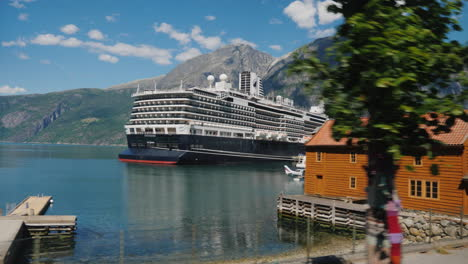 Drive-Along-The-Picturesque-Fjord-Where-A-Large-Ocean-Liner-Is-Moored