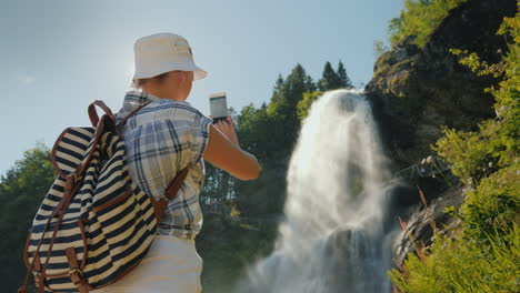 Traveler-Takes-Pictures-Of-Majestic-Steinsdalsfossen-Is-A-Waterfall-In-The-West-Of-Norway-4k-Video
