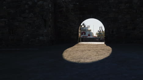 View-Of-The-Sea-Port-Through-The-Arch-Of-The-Ancient-Fortress-Wall-The-Shadow-Creates-A-Beautiful-Ov