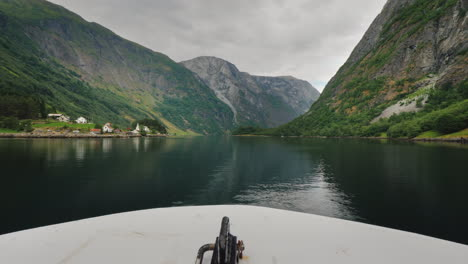 The-Nose-Of-A-Cruise-Ship-Sails-Along-The-Picturesque-Fjord-In-Norway-A-Journey-Through-The-Pictures