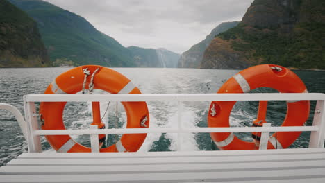 Cruise-Ship-Cruise-With-Two-Lifebuoys-In-The-Background-The-Picturesque-Norwegian-Fjord-4k-Video