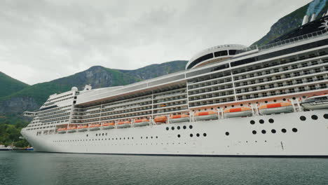 A-Huge-Ocean-Liner-Is-Moored-Off-The-Coast-Of-The-Picturesque-Norwegian-Fjord-4k-Video