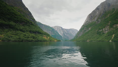 Fly-Low-Over-The-Surface-Of-The-Water-In-The-Picturesque-Fjord-Of-Norway-The-Beautiful-Nature-Of-Sca