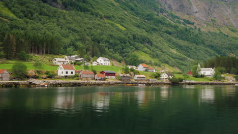 A-Picturesque-Village-With-Traditional-Wooden-Houses-On-The-Shore-Of-The-Fjord-In-Norway-View-From-A