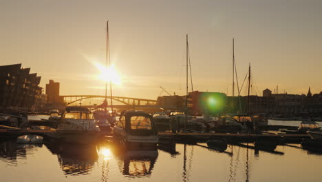 Pier-With-Yachts-In-The-Prestigious-District-Of-Bergen-In-Norway-The-Setting-Sun-Is-Reflected-In-The