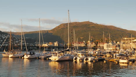 A-Number-Of-Small-Yachts-Are-Moored-In-A-Picturesque-Place-In-The-Background-Of-The-Mountain-The-Cit