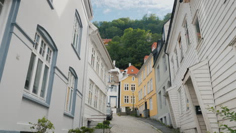 A-Narrow-Street-With-Beautiful-Old-Wooden-Houses-In-Bergen-Norway-Steadicam-Shot