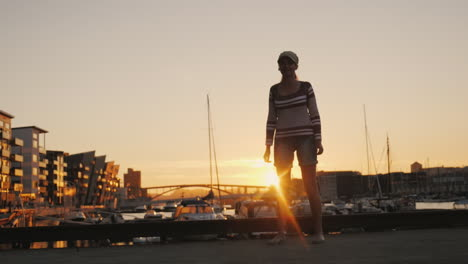 Active-Woman-Rejoices-At-Sunrise-Over-The-Marina-Runs-Forward-Raises-His-Hands-Up-Sunrise-In-Bergen