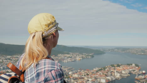 A-Woman-Tourist-Admires-A-Beautiful-View-Of-The-City-Of-Bergen-In-Norway-Tourism-In-Scandinavia-Conc