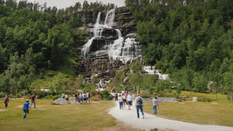 A-Group-Of-Tourists-Walk-Around-The-Highest-Waterfall-In-Norway-According-To-Legend-Water-From-The-W