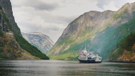 A-Small-Cruise-Ship-With-Tourists-Begins-A-Trip-To-The-Fjord-In-Norway-Travel-And-Tourism-In-Scandin