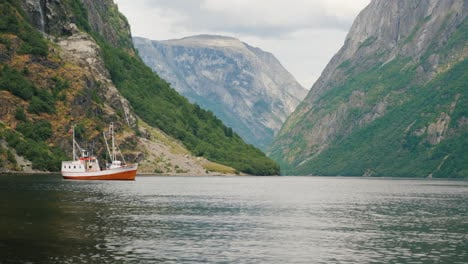 A-Small-Boat-In-The-Waters-Of-A-Majestic-Fjord-In-Norway-4k-Video