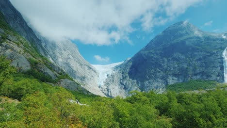 Beautiful-Waterfall-From-The-Waters-Of-The-Glacier-In-The-Background-The-Mountain-With-Ice-On-Top-Is